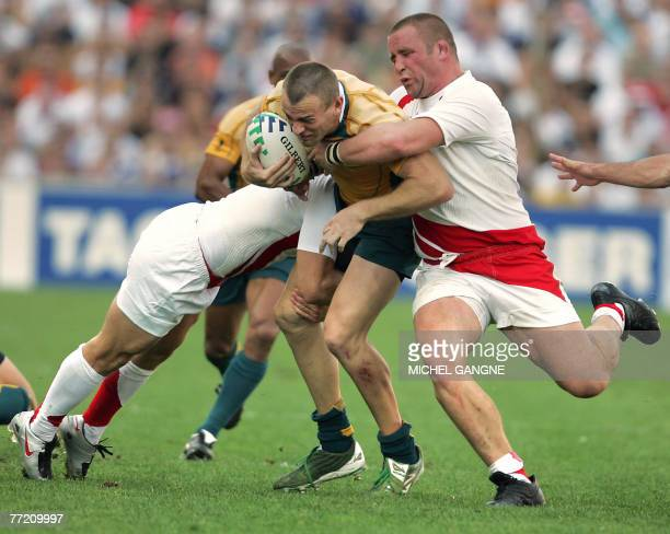 Australia's fullback Chris Latham fights for the ball with England's prop and captain Phil Vickery during the rugby union World Cup quarter final...