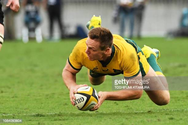 Australia's fullback Dane HaylettPetty dives with the ball during the Bledisloe Cup rugby union Test match between the New Zealand All Blacks and...