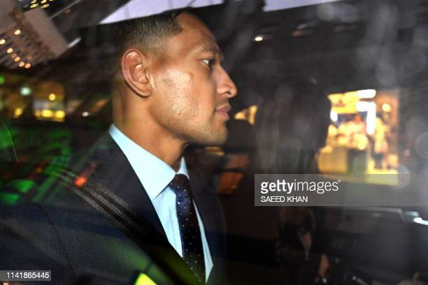 TOPSHOT Australia's fullback Israel Folau leaves after a code of conduct hearing in Sydney on May 7 2019 NSW Waratahs chairman Roger Davis on May 7...