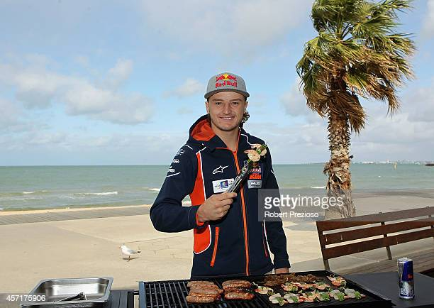 Australia's future star of MotoGP Jack Miller cooks an Aussie BBQ on the foreshore of St Kilda Sea Baths on October 14, 2014 in Melbourne, Australia.