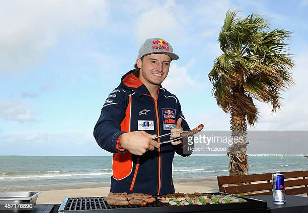 Australia's future star of MotoGP Jack Miller cooks an Aussie BBQ on the foreshore of St Kilda Sea Baths on October 14 2014 in Melbourne Australia