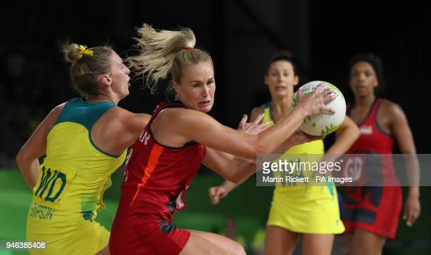 Australia's Gabi Simpson and England's Chelsea Pitman in action in the Women's Netball gold medal match at the Coomera Indoor Sports Centre during...