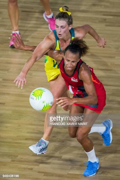 Australia's Gabi Simpson and England's Serena Guthrie compete for the bale during their women's field netball gold medal match of the 2018 Gold Coast...