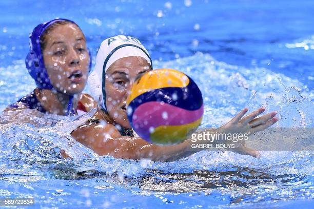 Australia's Gemma Beadworth vies with Hungary's Gabriella Szucs during the Rio 2016 Olympic Games waterpolo qarterfinal match at the Olympic Aquatics...