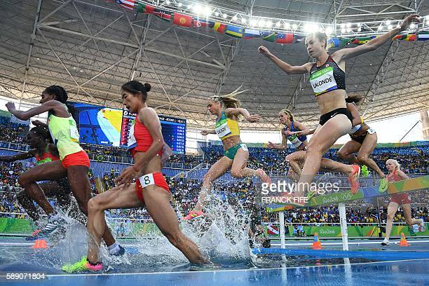 Australia's Genevieve Lacaze and Canada's Genevive Lalonde compete in the Women's 3000m Steeplechase Round 1 during the athletics event at the Rio...