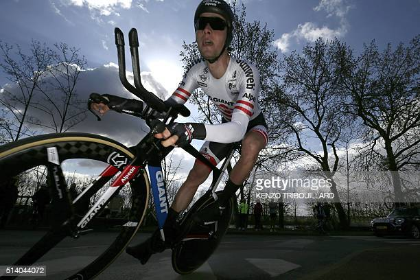 TOPSHOT Australia's Georg Preidler competes during the 61 km individual timetrial on March 6 2016 in ConflansSainteHonorine during the 74th edition...