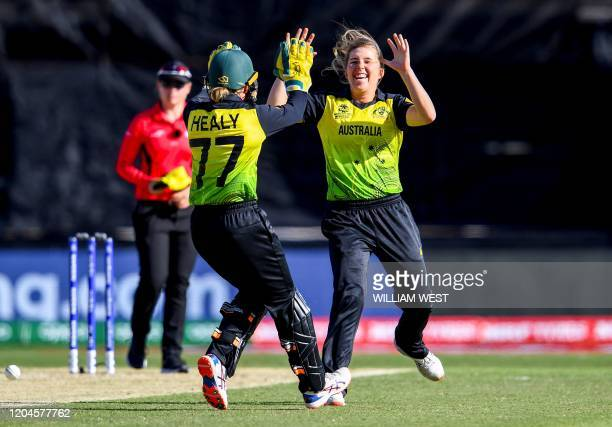 Australia's Georgia Wareham celebrates with Alyssa Healy after dismissing New Zealand's captain Sophie Devine in their Twenty20 women's World Cup...
