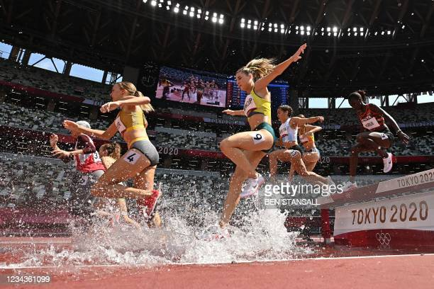 Australia's Georgia Winkcup competes in the women's 3000m steeplechase heats during the Tokyo 2020 Olympic Games at the Olympic Stadium in Tokyo on...
