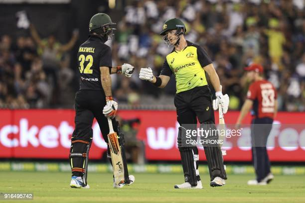 Australia's Glen Maxwell and D'Arcy Short congratulate one another during the Twenty20 International TriSeries cricket match between England and...