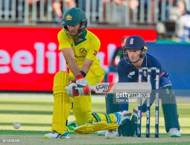 Australia's Glen Maxwell plays a reverse sweep shot watched by England's wicketkeeper Jos Buttler during the fifth oneday international cricket match...