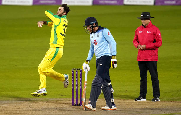Australia's Glenn Maxwell bowls as England's Jonny Bairstow looks on during the first Royal London ODI match at Emirates Old Trafford Manchester