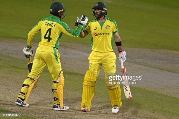 TOPSHOT Australia's Glenn Maxwell congratulates teammate Alex Carey after he scored a century during the oneday international cricket match between...