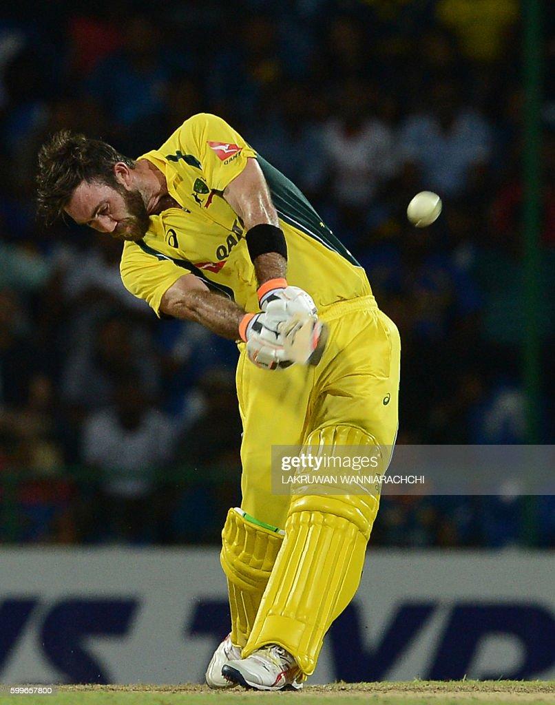 Australia's Glenn Maxwell hits a shot during the first T20 international cricket match between Sri Lanka and Australia at the Pallekele International Cricket Stadium in Pallekele on September 6, 2016. / AFP / LAKRUWAN