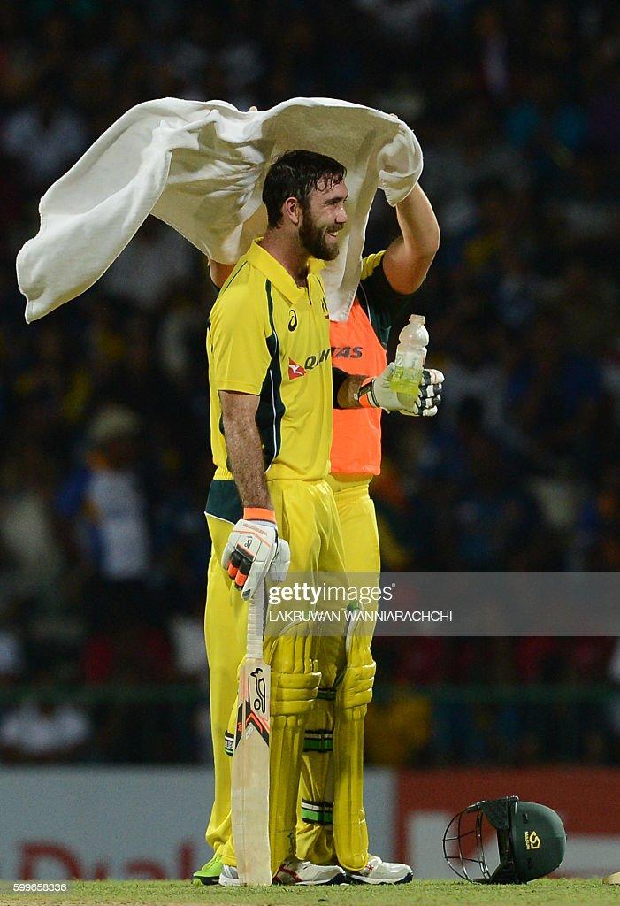Australia's Glenn Maxwell takes a drink break during the first T20 international cricket match between Sri Lanka and Australia at the Pallekele International Cricket Stadium in Pallekele on September 6, 2016. / AFP / LAKRUWAN