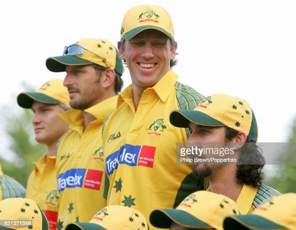 Australia's Glenn McGrath laughs as teammate Jason Gillespie makes himself shorter during the official team photo before the tour match between PCA...