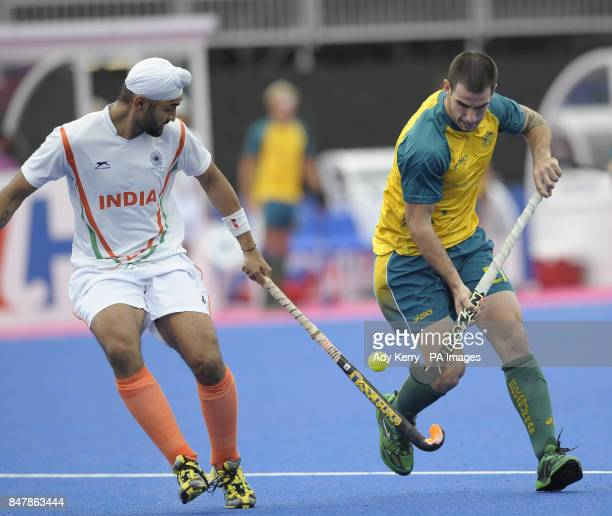 Australia's Glenn Simpson challenges with India's Sandeep Singh during the Visa International Invitational Hockey Tournament at the Riverbank Arena...