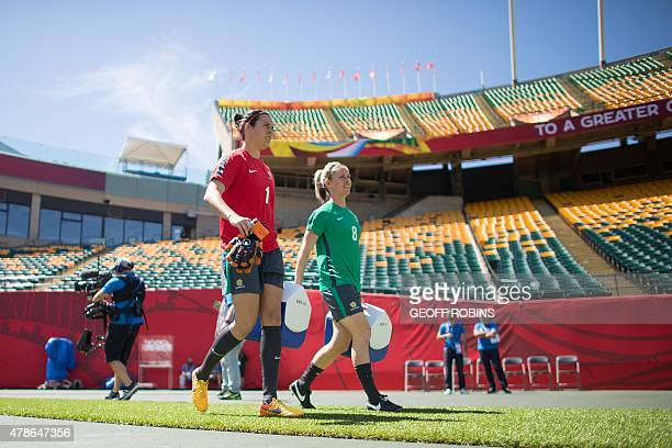 Australia's goalkeeper Lydia Williams and defender Elise Kellond arrive for the team's training session in Edmonton Alberta on June 26 2015 Australia...