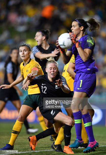 Australia's goalkeeper Lydia Williams blocks an attack during the Women's Cup of Nations football match against New Zealand in Sydney on February 28...