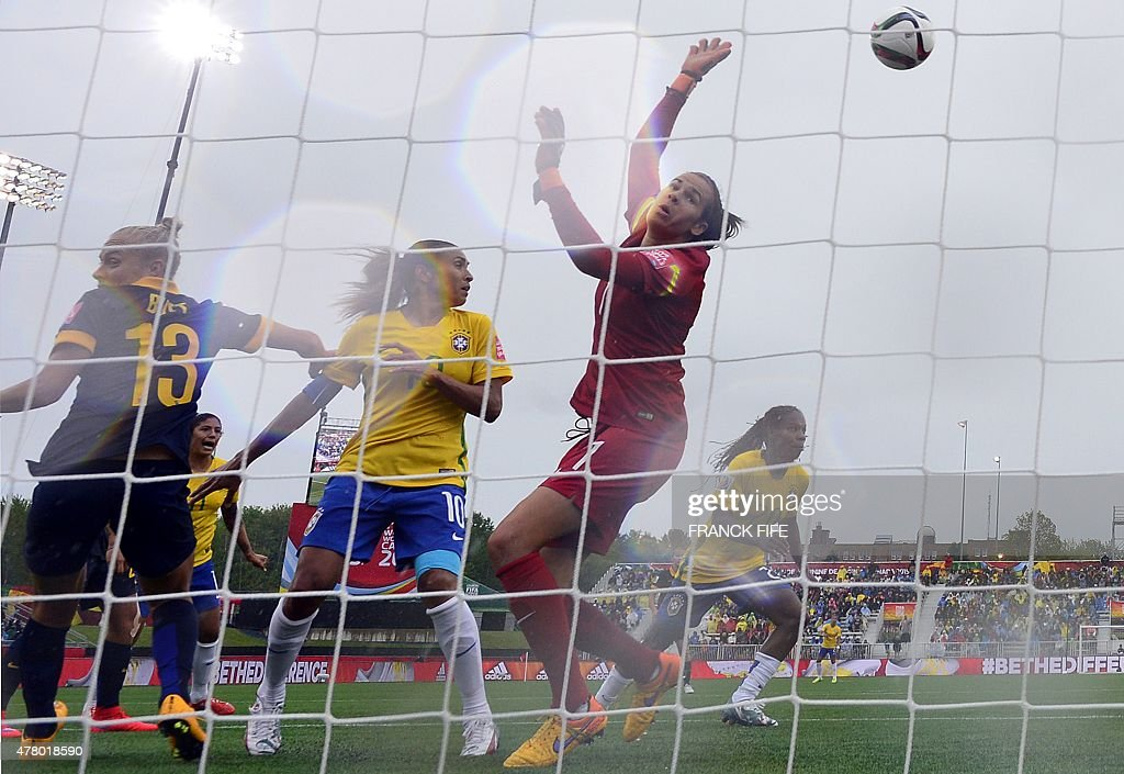 Australia's goalkeeper Lydia Williams(C_red) makes a stop during their 2015 FIFA Women's World Cup round of 16 match against Brazil at Moncton Stadium, in New Brunswick, Canada on June 21, 2015.