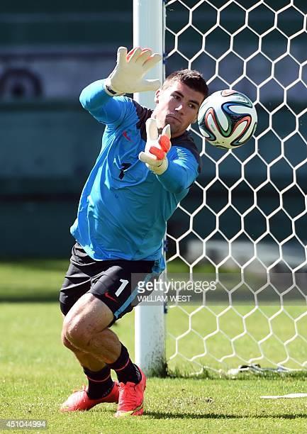 Australia's goalkeeper Mathew Ryan blocks a shot on goal during their last team training session in Curitiba Brazil on June 22 2014 Australia will...