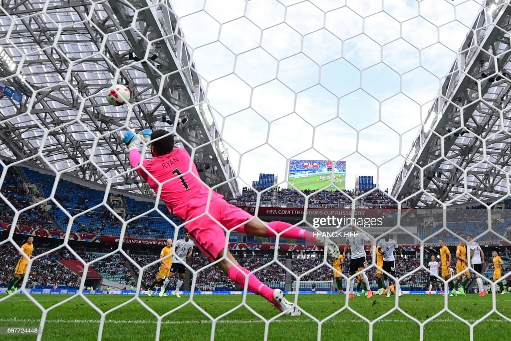 Australia's goalkeeper Mathew Ryan dives to block a shot on goal during the 2017 Confederations Cup group B football match between Australia and Germany at the Fisht Stadium in Sochi on June 19, 2017. /