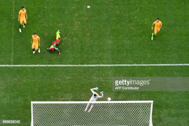 Australia's goalkeeper Mathew Ryan jumps to deflect the ball during the 2017 Confederations Cup group B football match between Cameroon and Australia...