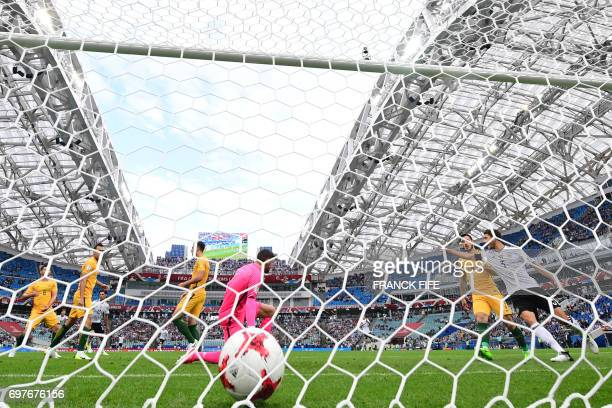 TOPSHOT Australia's goalkeeper Mathew Ryan misses the ball to give Germany the first goal of the match during the 2017 Confederations Cup group B...