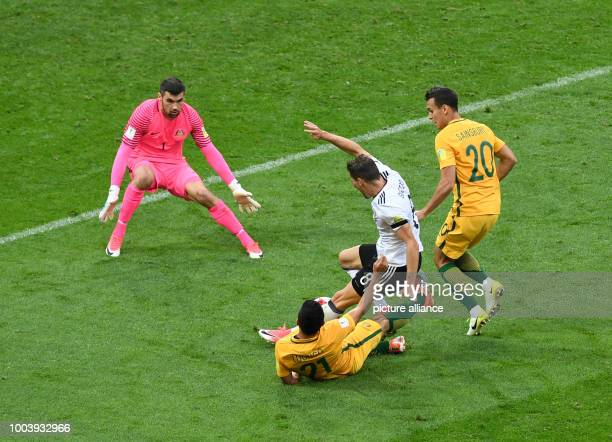 Australia's goalkeeper Maty Ryan watches as his teammate Massimo Luongo fouls Germany's Leon Goretzka to concede a penalty during the Confederations...