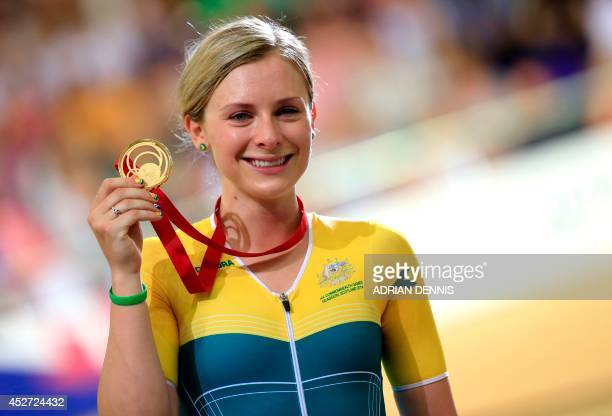 Australia's gold medalist Annette Edmondson poses on the podium after winning the women's 10km scratch race in the in the Sir Chris Hoy Velodrome...