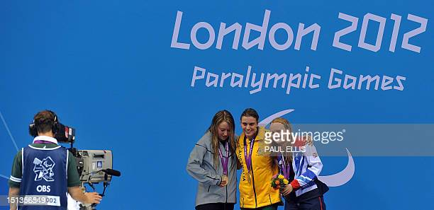 Australia's gold medallist Jacqueline Freney poses on the podium flanked by US silver medallist Cortney Jordan and Britain's bronze medallist...
