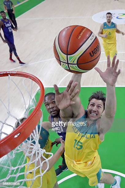 Australia's guard Damian Martin and USA's guard Kevin Durant go for a rebound during a Men's round Group A basketball match between Australia and USA...