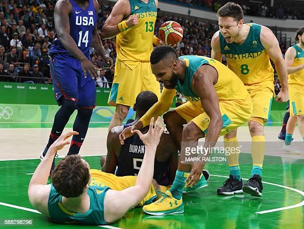 Australia's guard Matthew Dellavedova and Australia's guard Patty Mills cheer on Australia's forward Cameron Bairstow after USA's guard Kevin Durant...