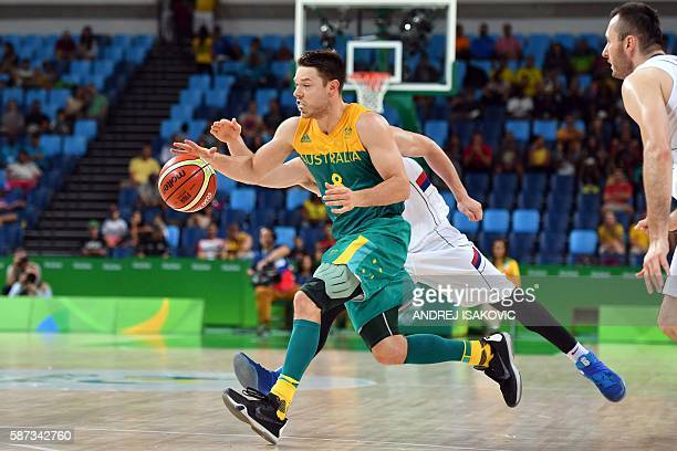 Australia's guard Matthew Dellavedova dribbles during a Men's round Group A basketball match between Serbia and Australia at the Carioca Arena 1 in...