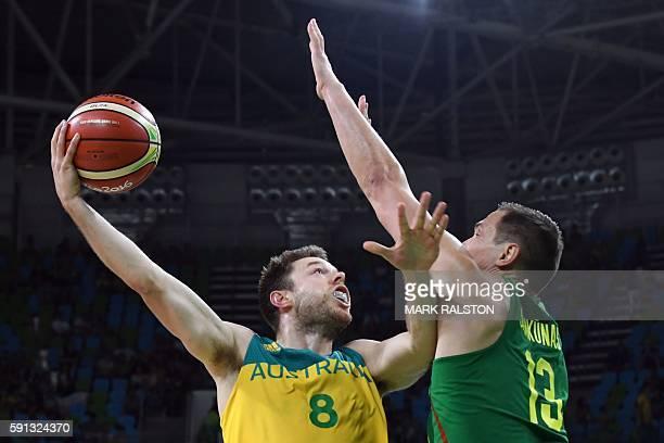 Australia's guard Matthew Dellavedova goes to the basket against Lithuania's power forward Paulius Jankunas during a Men's quarterfinal basketball...