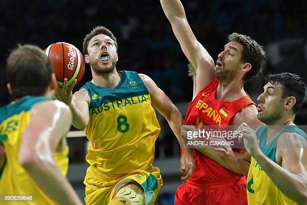 Australia's guard Matthew Dellavedova goes to the basket despite Spain's centre Pau Gasol as Australia's centre Andrew Bogut looks on during a Men's...