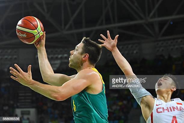 Australia's guard Matthew Dellavedova goes to the basket despite China's guard Zhao Jiwei during a Men's round Group A basketball match between China...