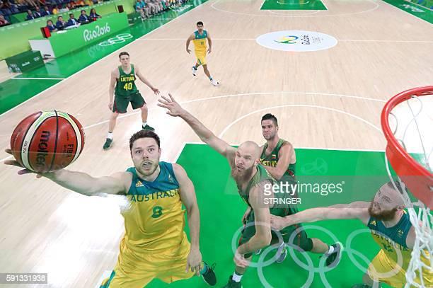 Australia's guard Matthew Dellavedova jumps for a basket by Lithuania's centre Antanas Kavaliauskas during a Men's quarterfinal basketball match...