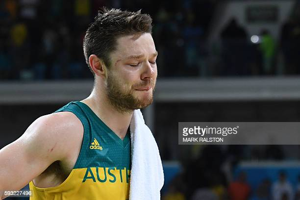 Australia's guard Matthew Dellavedova reacts after losing a Men's Bronze medal basketball match between Australia and Spain at the Carioca Arena 1 in...