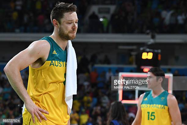 TOPSHOT Australia's guard Matthew Dellavedova reacts after losing a Men's Bronze medal basketball match between Australia and Spain at the Carioca...