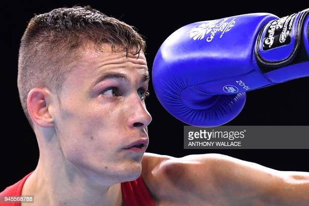 TOPSHOT Australia's Harry Garside eyes a punch from Wales' Michael McDonagh during their men's 60kg semifinal boxing match during the 2018 Gold Coast...