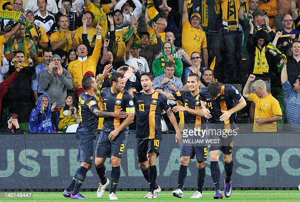 Australia's Harry Kewell is congratulated by teammates after scoring against Saudi Arabia in their 2014 World Cup qualifying match in Melbourne on...