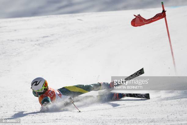 Australia's Harry Laidlaw falls during the Men's Giant Slalom at the Jeongseon Alpine Center during the Pyeongchang 2018 Winter Olympic Games in...