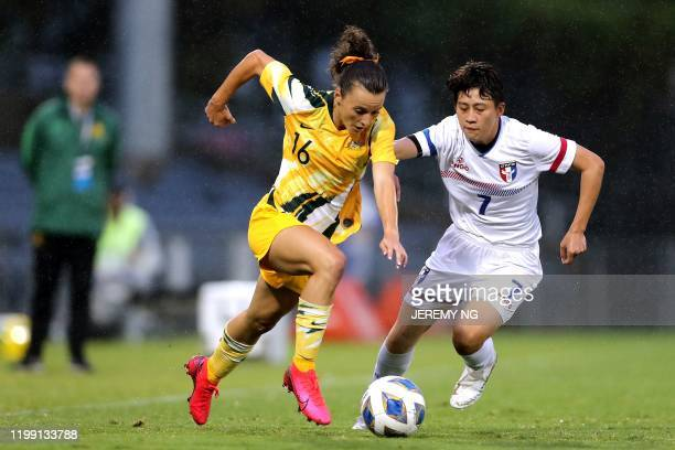 Australias Hayley Raso and Taiwan's Chen Yen-ping challenge for the ball during the women's Olympic football tournament qualifier match between...
