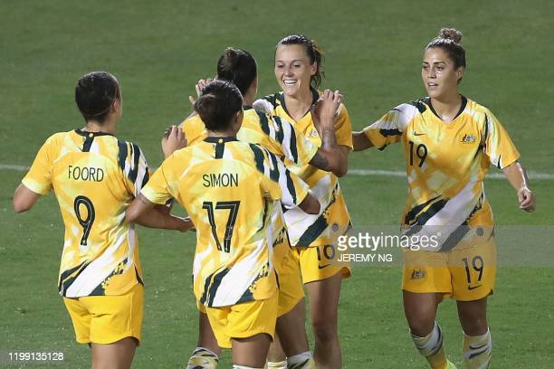 Australia's Hayley Raso celebrates her goal with her teammates during the women's Olympic football tournament qualifier match between Taiwan and...