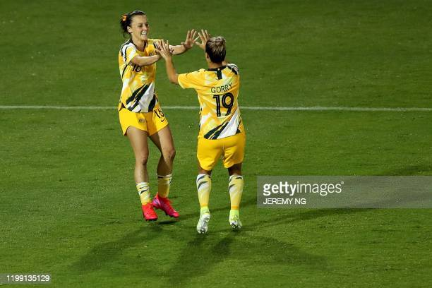 Australia's Hayley Raso celebrates her goal with Katrina Gorry during the women's Olympic football tournament qualifier match between Taiwan and...
