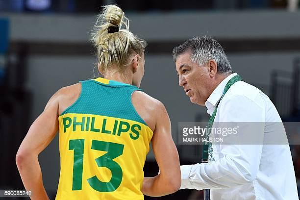 Australia's head coach Brendan Joyce talks to Australia's shooting guard Erin Phillips during a Women's quarterfinal basketball match between...