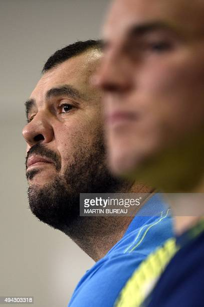 Australia's head coach Michael Cheika and Australia's hooker and captain Stephen Moore attend a press conference in Teddington west London on October...