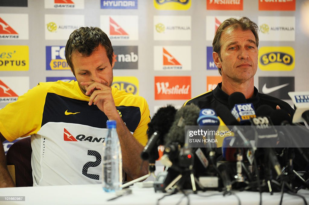 Australia's head coach Pim Verbeek (R) and defender Lucas Neill announce that goalkeeper Brad Jones will be leaving for a family emergency during a press conference in Roodeport on June 7, 2010 ahead of the 2010 World Cup football tournament. Pim said Jones is not expected to return for the start of the World Cup.