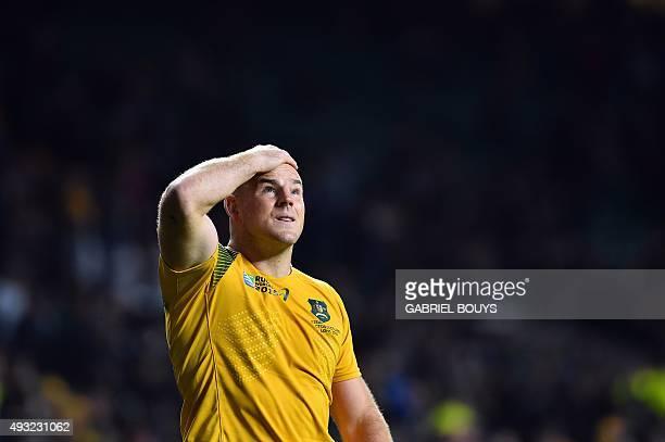 Australia's hooker and captain Stephen Moore celebrates after winning a quarter final match of the 2015 Rugby World Cup between Australia and...