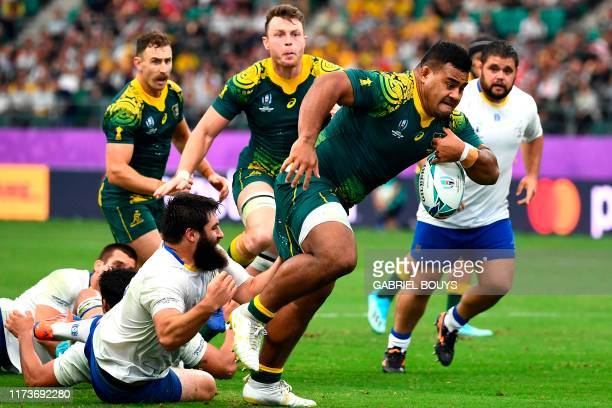 Australia's hooker Folau Fainga'a avoids a tackle during the Japan 2019 Rugby World Cup Pool D match between Australia and Uruguay at the Oita...